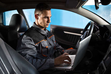 Mechanical check the car electronics with laptop, using diagnostic equipment