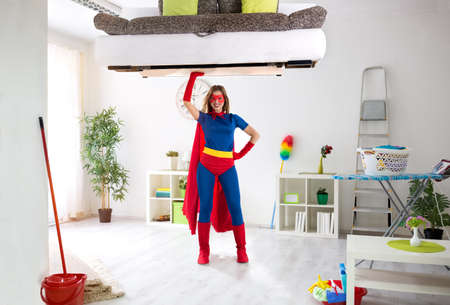 Super hero woman ready for cleaning house, housework concept Standard-Bild