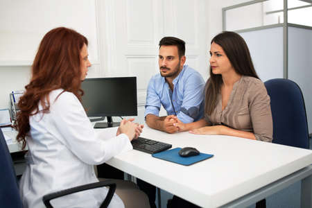 Husband and wife in a clinic, Beautiful young couple at pregnancy consultation period Stockfoto