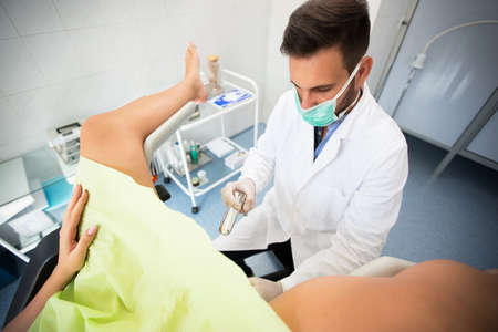 Beautiful young woman lying in gynecology clinic doing examination. Standard-Bild