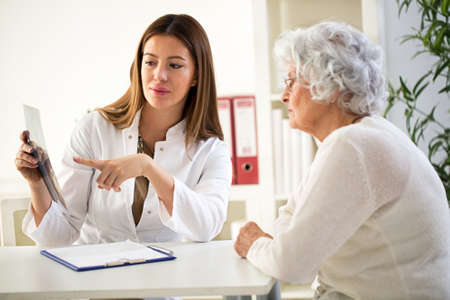 health professional: Doctor and patient discussing scan results in hospital