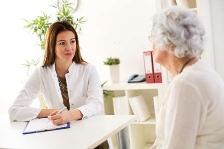 Senior woman visiting a doctor in hospital