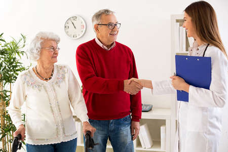 frailty: Senior couple visit doctor about medic consultation in ambulance Stock Photo