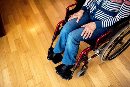 Sad depression loneliness senior woman in wheelchair at nursing home