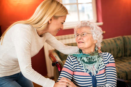 Young woman visit grandmother and support her about health, family care concept