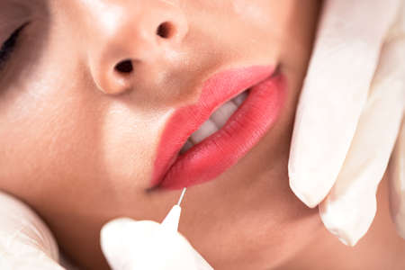 Microblading technique being applied for creating of kissable lips