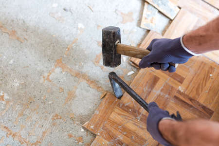 Hammer and a crowbar joining forces in the hands of a well trained worker