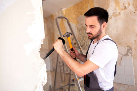 In crafty hands of an experienced worker wall demolition looks very easy