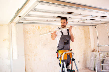 Using a properly measured ceiling plank emphasizes neatness in a job well done