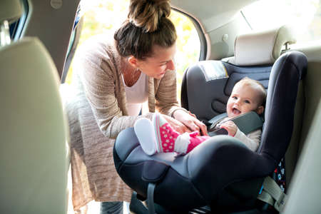 Cute baby in infant car seat perfectly designed to satisfy needs of a little child