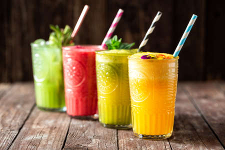 Four smoothies with great taste and instant energy boost packed with essential nutrients for body nourishment, just living healthy Фото со стока