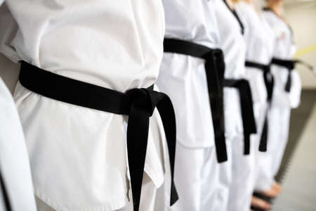 Black belts in close up mode representing devotion and discipline Stock Photo