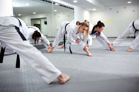Martial art taekwondo combat fighters stretching and warming up insuring no injuries take place