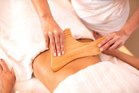 Stomach area massage, abdominal massage, maderotherapy, body massage concept