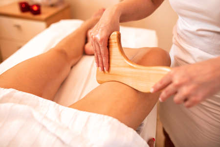 Wooden instruments applied with a massage purpose, thigh massage