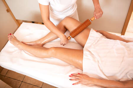 Maderotherapy on a pair of sexy legs, anti-cellulite therapy
