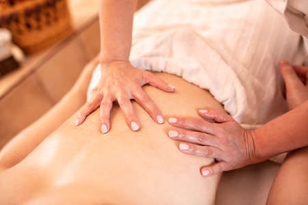 Man having a health enhancement and skin nourishment massage, relaxation therapy