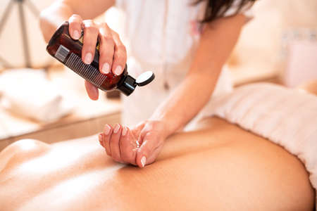 Back area massage therapy with special oil, relaxation massage