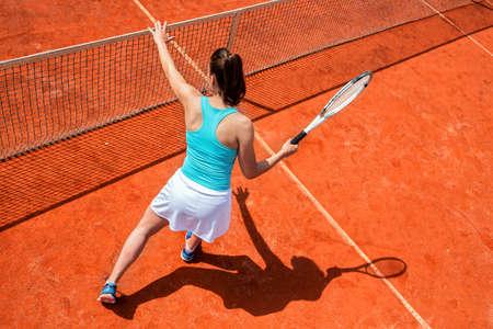 Jugador de tenis femenino en la red, práctica de tenis Foto de archivo