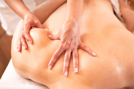 Muscular having a massage of the shoulder area, muscle recovery therapy