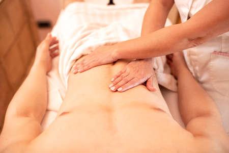 Hand massage treatment for stomach area, abdominal massage