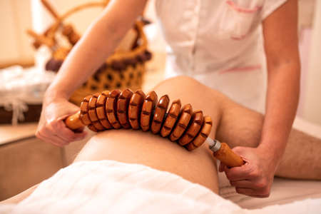 Flexible wooden roller thigh massage for muscle forming and stimulating circulation