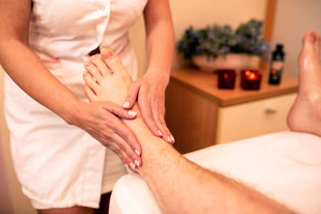 Foot massage for increasing joint flexibility and motion range, leg massage