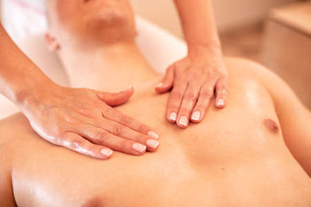 Chest massage in close up, massage therapy with bare hands