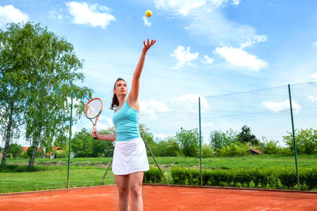Practicing of correct serve technique in tennis, tennis for women Stock Photo