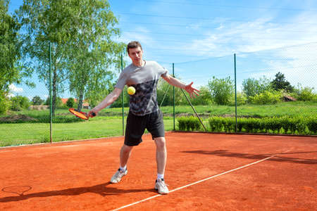 Tennis player approaching for a forehand shot, tennis practice
