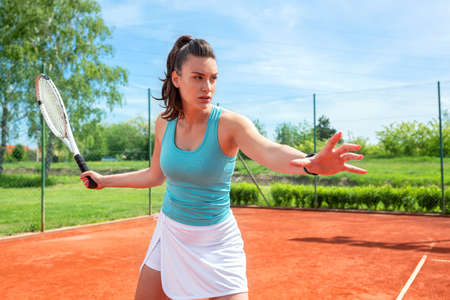 Young woman having outdoor tennis practice, tennis concept Stock Photo - 135482597