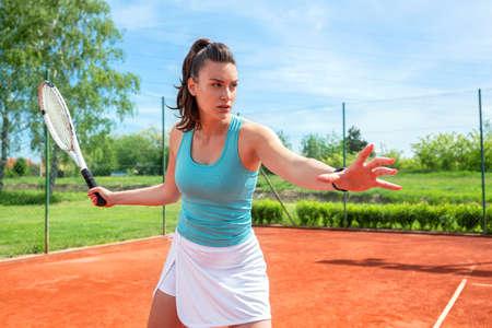 Young woman having outdoor tennis practice, tennis concept