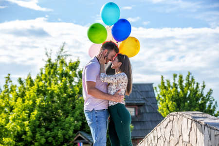Romance under the colorful balloons, people in love