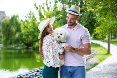 Lovely couple and their pet having a great time