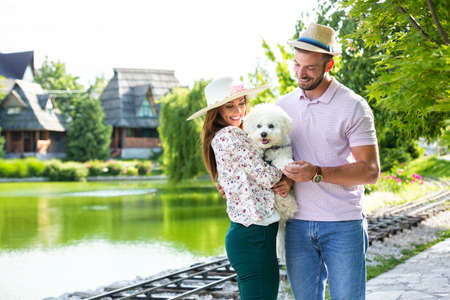 Two people loving each other and their cute dog Stock Photo