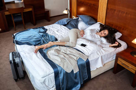 Elegant brunette woman sleeping during day, tired young woman
