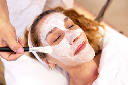 Older woman with cosmetics beauty mask designed to tighten and improve the contours of the face, concept of pretty skin