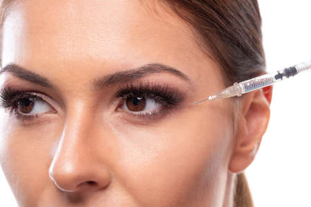 Facial treatment for removing wrinkles with an injection, smooth skin concept 写真素材