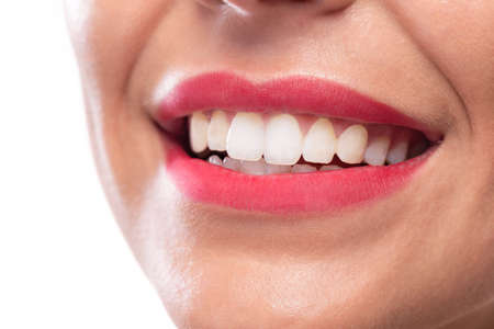 Shining white teeth and a beautiful smile for maintaining good oral hygiene