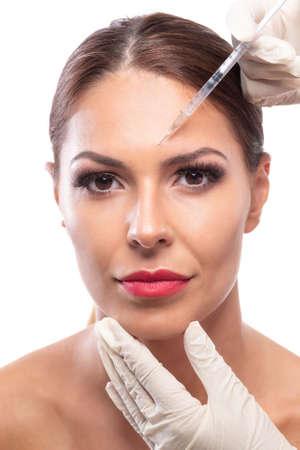 Beautiful woman having an antiaging treatment, repairing facial skin 写真素材