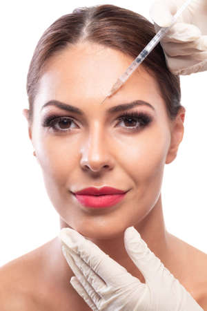 Attractive woman having wrinkle removing treatment making her skin young and beautiful 写真素材