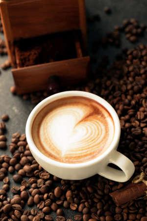 Latte art on a tide of coffee beans, coffee background Stock fotó
