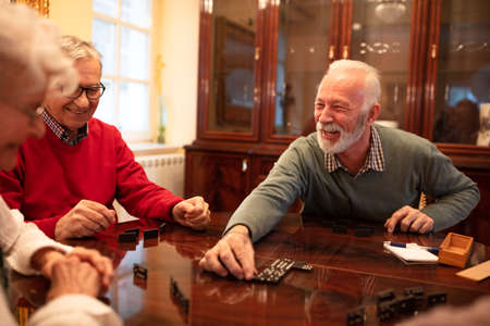 Older folks enjoying playing board games in a nursing home