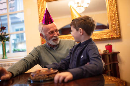 Grandfather and grandson having a party, birthday surprise