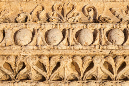 sculpture in stone column at Temple of Bel in Palmyra in Syria Stock Photo