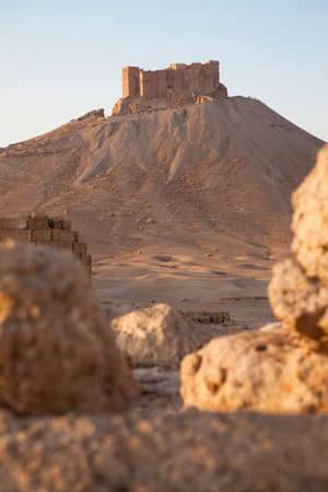 monumental: monumental ancient fortress on hill in desert at Palmyra, Syria Stock Photo