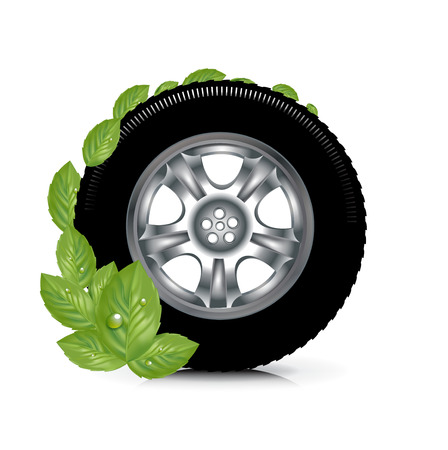 car wheel and green leaves; green energy concept isolated on white