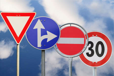 Many different road signson cloudy background photo