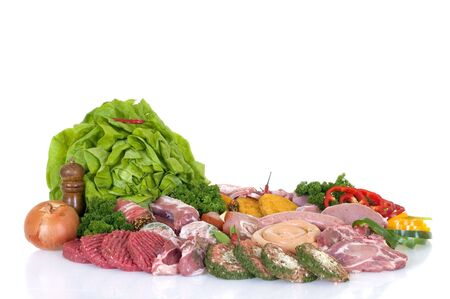 garnished: Variety of fresh meat garnished with lettuce and parsley, studio shot,