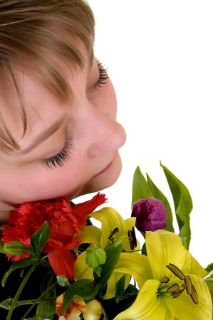 Young dreamy teenager girl with flowers white background, studio shot Stock Photo - 2938841